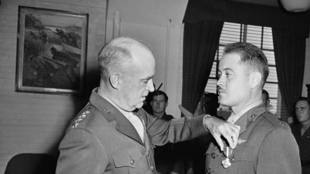 Lt. Col. Gregory (Pappy) Boyington, right, receives the Navy Cross from Gen. A. A. Vandergrift, Marine Corps Commandant during a ceremony at Marine Headquarters in Washington, D.C., Oct. 4, 1945.