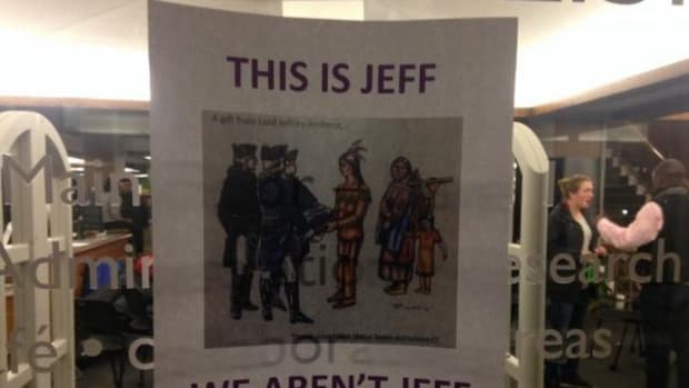 A poster protesting Amherst College's mascot hangs in Robert Frost Library.