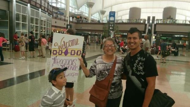 Grandma Rosalie Tallbull and grandson Mauricio greet Jeremy Thompson at Denver International Airport before the World Lacrosse Championships begin on July 10, 2014
