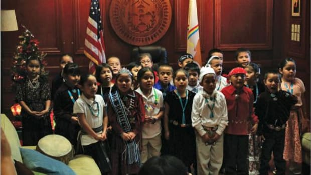 Students from Tsehootso Dine' Bi Olta' visited the Office of the President and Vice President to sing Christmas carols in Navajo.