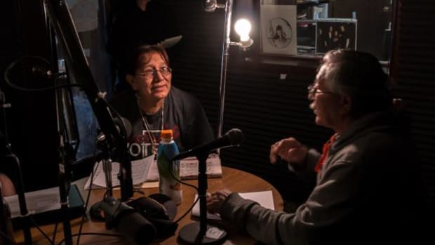 Tuned in: During a KILI radio program on Pine Ridge Indian Reservation, Beverly Pipe On Head and Cornell Conroy used Lakota and English to call on fellow tribal members to participate in the 2014 election.