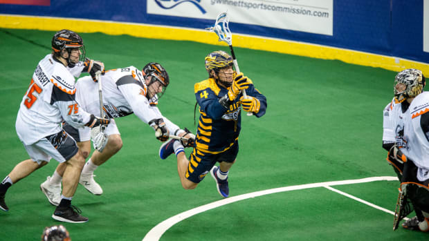 Flying through the air to make his move toward the goal, Georgia' Swarm's Lyle Thompson shows a good reason for being selected as the 2107 NLL MVP. - Kyle Hess