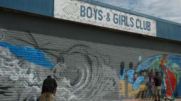 Nashon Russell and Eric Ortega, both San Carlos Apache, are two of the artists who volunteered their time to work on the mural on the Boys and Girls Club of the San Carlos Apache Nation building in southeastern Arizona. (Courtesy Boys and Girls Club of the San Carlos Apache Nation)