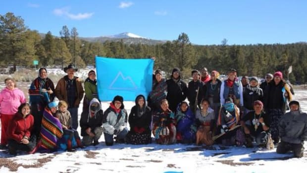 Community joins walkers at prayer ceremony at their destination on Tsoodzi? or Mount Taylor.