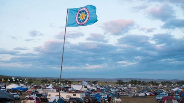 A Standing Rock Sioux flag flies over a protest encampment near Cannon Ball, North Dakota, where members of the Standing Rock nations and their supporters have gathered to voice their opposition to the Dakota Access Pipeline.
