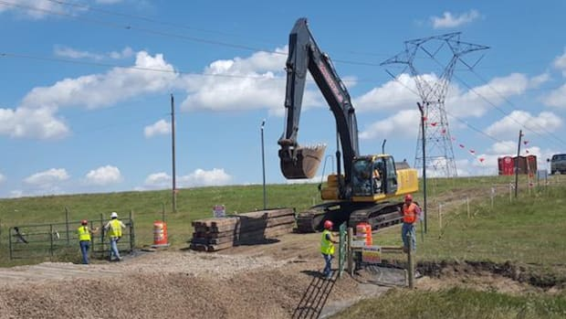 Construction equipment for the Dakota Access pipeline near the Standing Rock Sioux Reservation stood ready in mid-August, above. The tribe said that on Saturday September 3 a two-mile-long, 150-foot-wide swathe was cut through sacred sites and burial grounds, just a few days before a judge is scheduled to rule on an injunction that could halt the project.