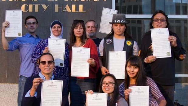 The Red Nation coalition holds signed copies of Albuquerque's Indigenous Peoples Day proclamation.
