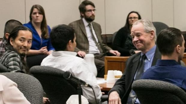 Alaska Innocence Project director Bill Oberly, right, and the Fairbanks Four at the hearing in which the four men were exonerated.