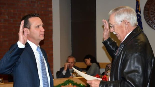 Nathan Barnard, of Tulsa, is sworn in as a member of the administrative appeals board by Cherokee Nation Supreme Court Justice John Garrett at the January Tribal Council meeting January 12.