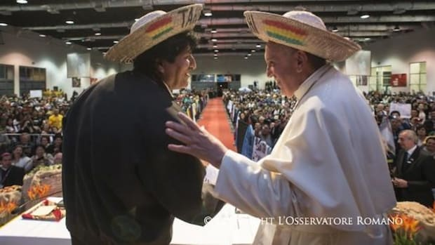 """The audience applauded loudly as Pope Francis, seen here with Bolivian President Evo Morales, apologized for the Catholic Church's role in committing the """"grave sins"""" of colonialism."""