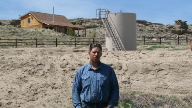 "This May 22, 2009 picture shows John Fenton, a farmer who lives near Pavillion in central Wyoming, near a tank used in natural gas extraction, in background. Fenton and some of his neighbors blame hydraulic fracturing, or ""fracking,"" a common technique used in drilling new oil and gas wells, for fouling their well water. The U.S. Environmental Protection Agency announced Thursday Dec. 8, 2011 in Wyoming, for the first time that fracking may be to blame for causing groundwater pollution. The EPA also emphasized that the findings are specific to the Pavillion area. The agency said the fracking that occurred in Pavillion differed from fracking methods used elsewhere in regions with different geological characteristics."