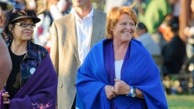 Diane Johnson, left, is heading Heidi Heitkamp's Native American campaign. They are seen here at the Fort Yates Powwow in July.