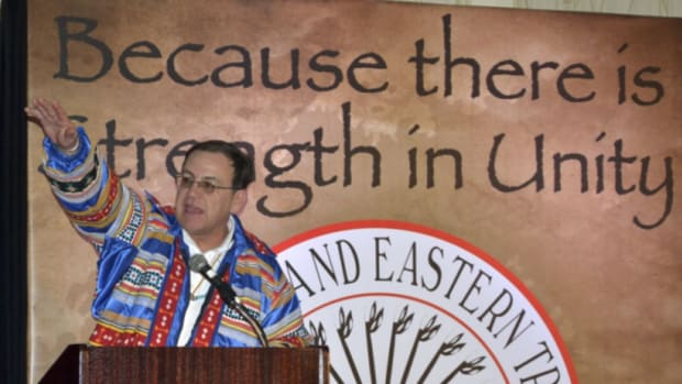 Brian Patterson, president of United South and Eastern Tribes (USET) on podium at a USET event in 2013.