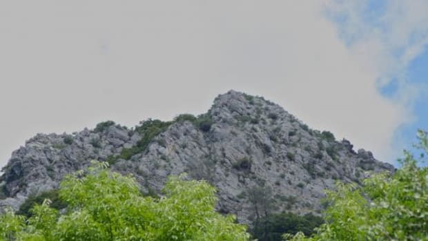 Two Sisters Mountain rises above the Winnemem Wintu's former village site, and its rocky crown is home to two spirit beings who provide teachings to young Winnemem women during their Coming of Age ceremonies.