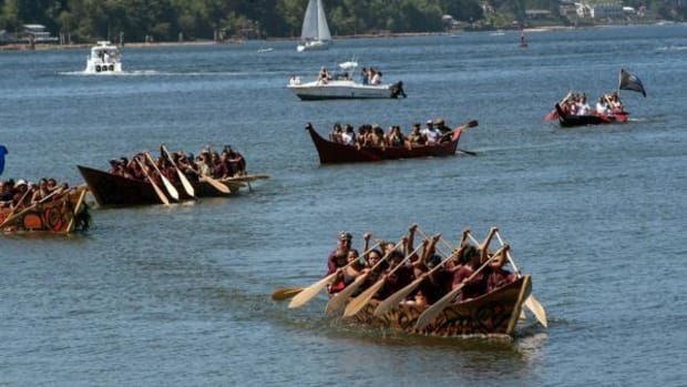 The Three Sisters canoes of the Nooksack/Shxwhá:y tribes, built by Shxwhá:y Master Carver Neil Russell Sr., arrive at the Port of Olympia, landing site of this year's Paddle to Nisqually.