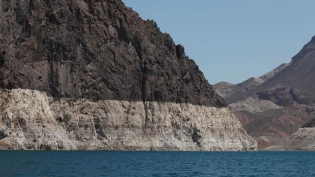 The calcium markings on the rock formations in Lake Mead, a Colorado River reservoir, show the impact of a 17-year drought on water levels. If the level drops below 1,025 feet, a state report says Arizona will lose access to 480,000 acre-feet of water from the Colorado River, or enough water for about a million family households for one year.