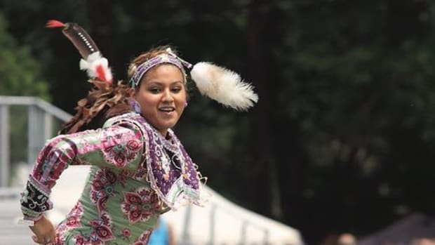 "Seneca Nation's Ann. Marvin ""Joe"" Curry Veterans Pow Wow in Salamanca, N.Y., July 17-19_ young dancer smiles as participates in teen smoke dance."
