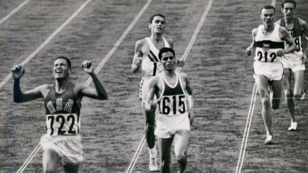 Billy Mills reacts after winning the gold medal in the 10,000 meter run at the 1964 Tokyo Olympics.