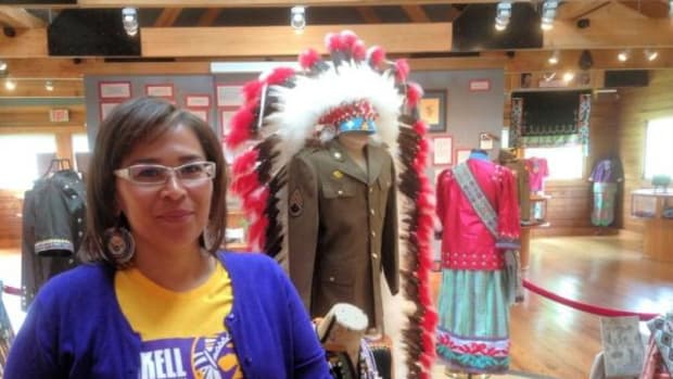 Jancita Warrington, the new director of the Haskell Cultural Center and Museum, stands with one of the new exhibits.