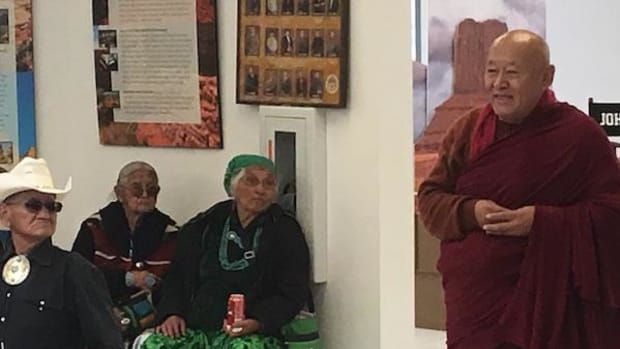 His Holiness the Drikung Kyabgön Chetsang, leader of the Kagyu school of Tibetan Buddhism, addresses Monument Valley residents during a May 18 meeting about Bears Ears National Monument.