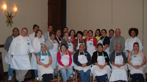 Chef Richard Hetzler (far left, 2nd row) and Miriam Menkir (far right, 2nd row) of the Mitsitam Native Foods Cafe lead the 2nd Annual Intertribal Solutions Cooking Class at the Prairie Band Casino and Resort. (Lorrraine Jessepe)