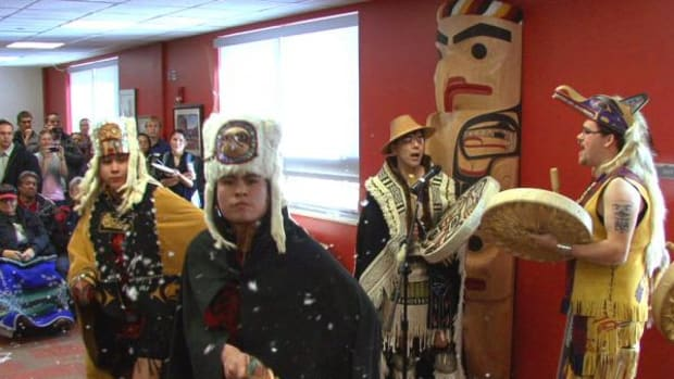 David Boxley, Tsimshian (nearest the totem pole), and his dance troupe, Git Hoan, performed traditional Native dances at the unveiling of the totem pole he carved for the Native American Center at Fort Lewis College, in Durango, Colorado on January 16. (Photos courtesy Fort Lewis College)