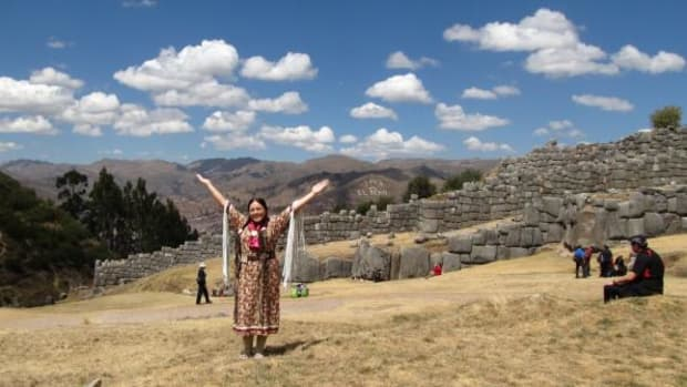 Christina Thomas stands at the Inca fortress, Sacsayhuaman, where the World Indigenous People's Conference opening ceremony was held. Indigenous Peoples from around the world were in attendance wearing their traditional clothing. The fortress was also a temple to worship the sun for the Inca people, as well as an astronomical site.