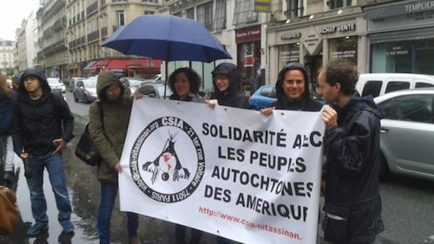 Tlingit Athabascan artist Crystal Worl, second from left holding banner, protested an auction of sacred items in Paris in May while in the city for an exhibition of her work. She also took time out to chat with Indian Country Today Media Network about her impressions of the metropolis nicknamed the City of Light.