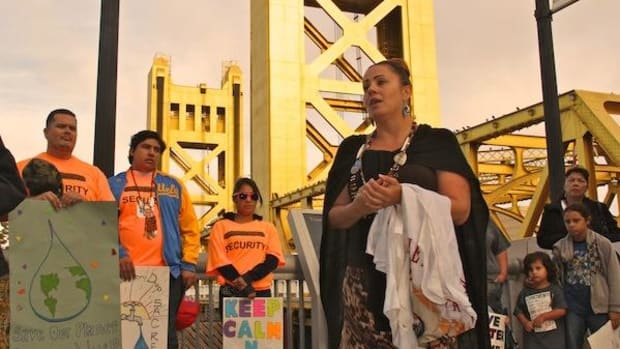 Rhonda Pope, tribal member of the Buena Vista Rancheria of Me-Wuk Indians and one of the organizers of the Water Is Sacred march to the California State Capitol, speaks to the marchers on Friday, September 26.