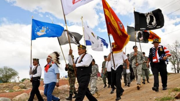 Veterans and elders make their way from Southern Ute Veterans Memorial Park on tribal campus to the Ouray Memorial Cemetery at the 2009 Day of Remembrance ceremonies.
