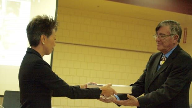 : John Yellowbird Steele receiving digitalized copies of traditional sacred and secular music from NEA chairman Jane Chu