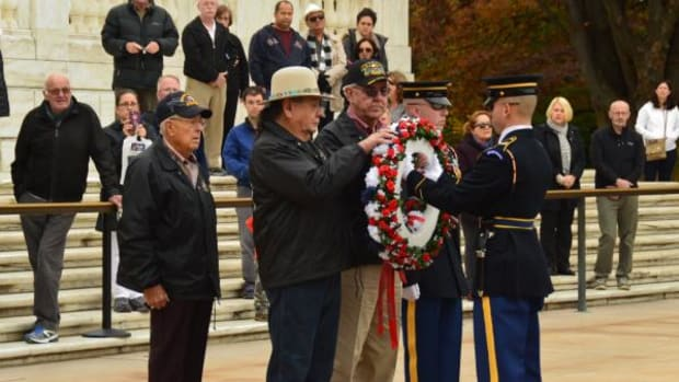 Three Chickasaw Nation citizens and war veterans lay a wreath at the Tomb of the Unknowns as they honor America's warriors during festivities commemorating Veterans Day. Chickasaws will tour many sites this week that honor American Veterans. The warriors are, from left, Johnny Swinney, Ranger, Texas; Jerry Tyson, San Antonio and Joe Orr, Frederick, Oklahoma. Tyson served 32 years in the U.S. Navy; Orr served in the U.S. Army for six years and Swinney served six years in the U.S. Air Force.