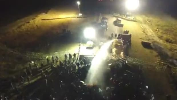 No fire trucks, or fires, in evidence as military vehicles fire water cannons at unarmed protectors in overnight conflict at DAPL in late November.