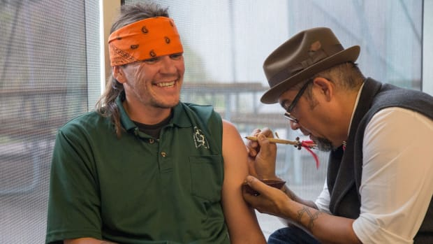 Ganondagan, a museum and former village site of the Seneca Nation, held its Tattoo Traditions of Turtle Island event on October 15th in Victor, NY to showcase Iroquoian and other nations traditional tattoos.- Elli Carr, Mohawk receiving his tattoo by a traditional artist.