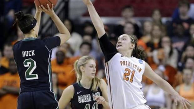 Green Bay guard Tesha Buck, No.2,  takes a shot against Princeton's forward Alex Wheatley during Saturday's NCAA Tournament. The Phoenix lost 80-70.