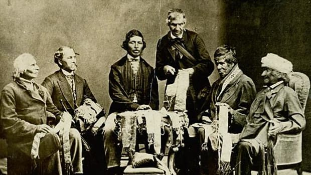 "Chiefs of the Six Nations at Brantford, Canada, explaining their wampum belts to Horatio Hale September 14, 1871. The image shows Joseph Snow (Hahriron), Onondaga Chief; George H.M. Johnson (Deyonhehgon), Mohawk chief, Government interpreter and son of John Smoke Johnson; John Buck (Skanawatih), Onondaga chief, hereditary keeper of the wampum; John Smoke Johnson (Sakayenkwaraton), Mohawk chief, speaker of the council; Isaac Hill (Kawenenseronton), Onondaga chief, fire keeper; John Seneca Johnson (Kanonkeredawih), Seneca chief. Hale inscribed these photographs, which he sent to colleagues, ""The wampum belts were explained to me on the reserve, at the residence of Chief G. H. M. Johnson; and at my request the chiefs afterwards came with me to Brantford, where the original photograph… was taken.—H. Hale, Clinton, Ont."" This copy of the photographs was one that belonged to J. N. B. Hewitt."
