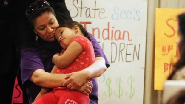 Madonna Pappan hugs her 4-year-old daughter Charlie Pappan before speaking at a press conference at the Adobe Eco Hotel in Rapid City, South Dakota on Thursday, March 21, 2013. Pappan, a resident of Pennington County and member of the Oglala Sioux Tribe, had her two children stripped from her custody in a hearing that lasted less than 60 seconds.