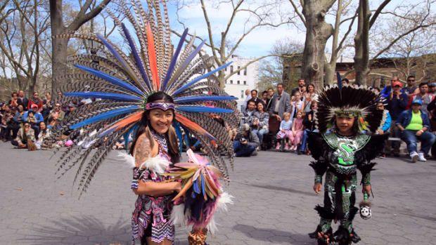 An Aztec dancer and her son pose after sharing their dances with the community as part of an event held April 23 to share indigenous culture with the local community.
