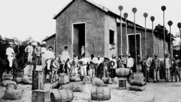 Photo from the early 1900s in Peru shows one of the stations in Arana's empire where rubber was stored and shipped.