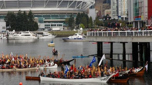Hundreds of paddlers took to Vancouver's False Creek the day before residential school hearings opened.