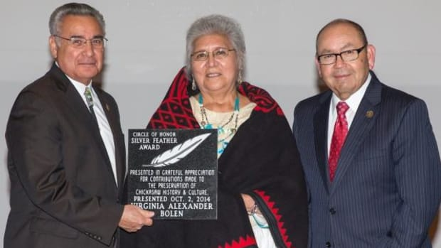 Chickasaw Nation Governor Bill Anoatubby, right, and Lt. Gov. Jefferson Keel present the 2014 Silver Feather Award to Ms. Virginia Alexander Bolen during the Chickasaw Nation Arts and Culture Awards ceremony Thursday, October 2, at the Chickasaw Cultural Center, Sulphur, Oklahoma.