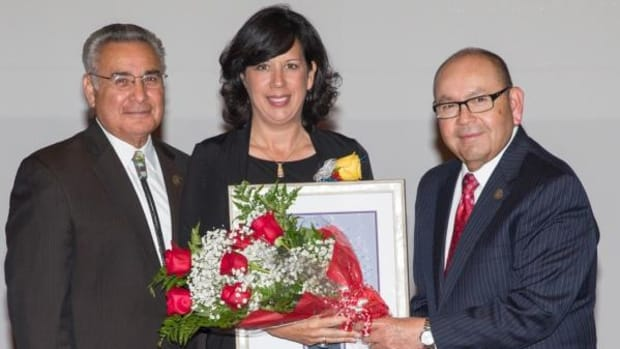 Chickasaw Nation Governor Bill Anoatubby, right, and Lt. Gov. Jefferson Keel present the 2014 Dynamic Woman of the Year Award to Dr. Karen Goodnight, Goldsby, during the Chickasaw Nation Arts and Culture Awards ceremony Thursday, October 2, at the Chickasaw Cultural Center, in Sulphur, Oklahoma.