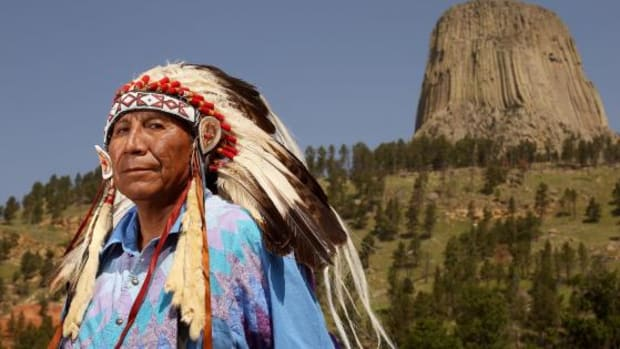 """Arvol Looking Horse stands in front of Mato Tipila, a sacred site in Wyoming. The sacred pipe, or """"canupa,"""" must be respected during talks regarding the Black Hills, Looking Horse, a nineteenth-generation pipe carrier, said."""