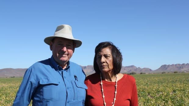 Ramona and Terry Button in their 50-plus acre tepary (or bavi) bean field in Arizona's Gila River Reservation.