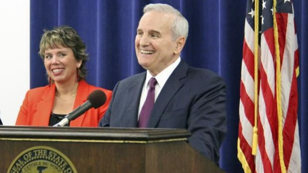 : Judge Anne McKeig stands with Minnesota Gov. Mark Dayton during the announcement June 28 that she will be the newest, and first Native, Minnesota Supreme Court justice.