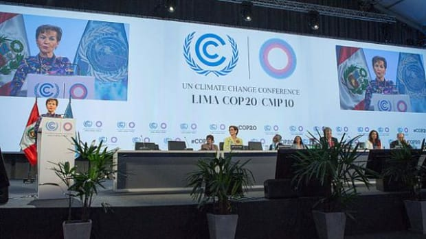 Christiana Figueres (L), executive secretary of the United Nations Framework Convention on Climate Change (UNFCCC) addresses the opening meeting of the plenary session.