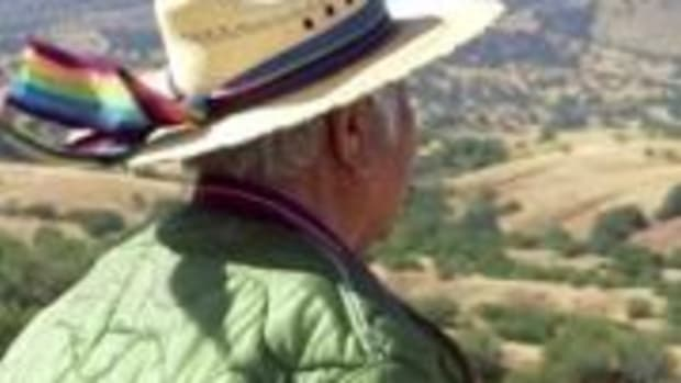 "An O'odham man looks out on the Santa Rita Mountains, the site of a proposed copper mine. The new documentary, ""Ours Is The Land,"" highlights issues with mining on sacred O'odham land."