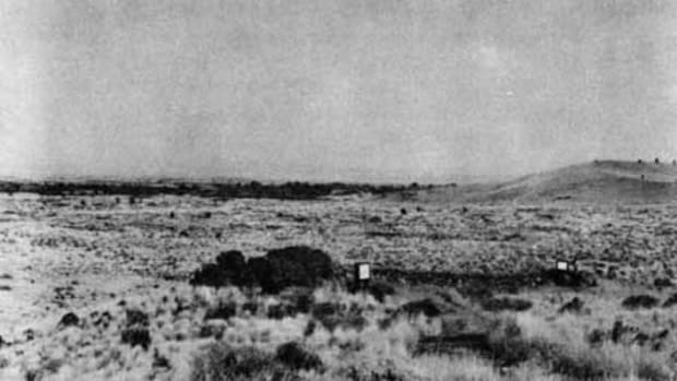 The low-lying area beyond the ranger is the general site where the Captain Evan Thomas's patrol was so devastatingly attacked by the Modocs. The hill to the right is the butte that was the object of the patrol (today called Hardin Butte).