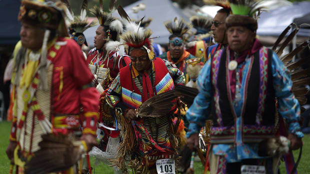 Northern traditional dancers enter the pow wow circle during grand entry at the 21st annual San Luis Rey Band of Mission Indians Pow Wow. Diego James Robles