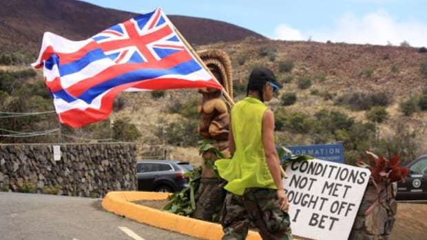 Protesters have formed a roadblock outside the Mauna Kea visitors' center in Hilo, Hawaii to halt the construction of a giant telescope on top of the sacred mountain.